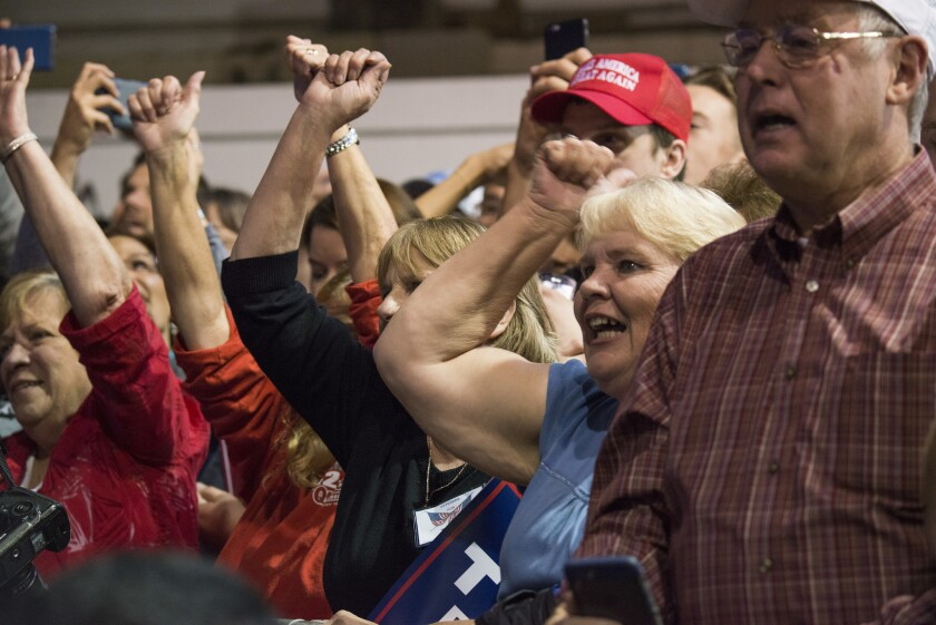 Supporters cheer Donald Trump at the county fairgrounds in Delaware, Ohio, on Thursday.