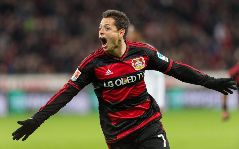 Bayer Leverkusen forward Javier Hernandez celebrates scoring a goal against VfL Wolfsburg in a Bundesliga match on Apr. 1.