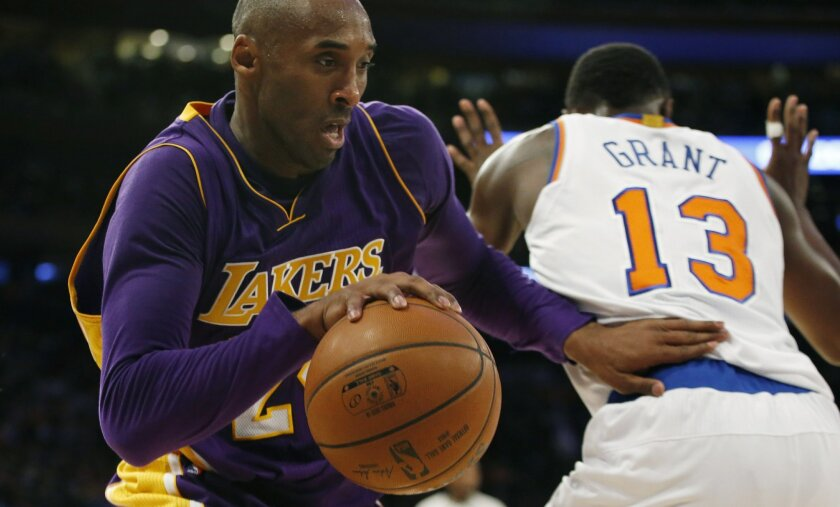 Los Angeles Lakers forward Kobe Bryant (24) drives around New York Knicks guard Jerian Grant (13) in the first half of an NBA basketball game at Madison Square Garden in New York, Sunday, Nov. 8, 2015.  (AP Photo/Kathy Willens)