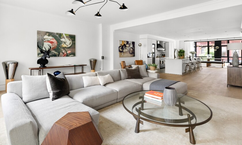 The full-floor condo in Lower Manhattan includes three bedrooms, three bathrooms and a 1,450-square-foot private terrace.