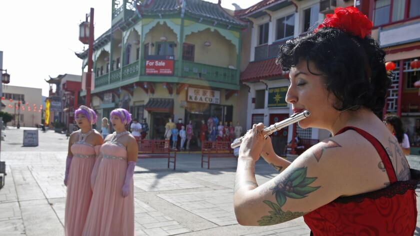 LOS ANGELES, CA. - OCTOBER 17, 2015: Chapter 15: Christine Tavolacci plays flute in China Town durin