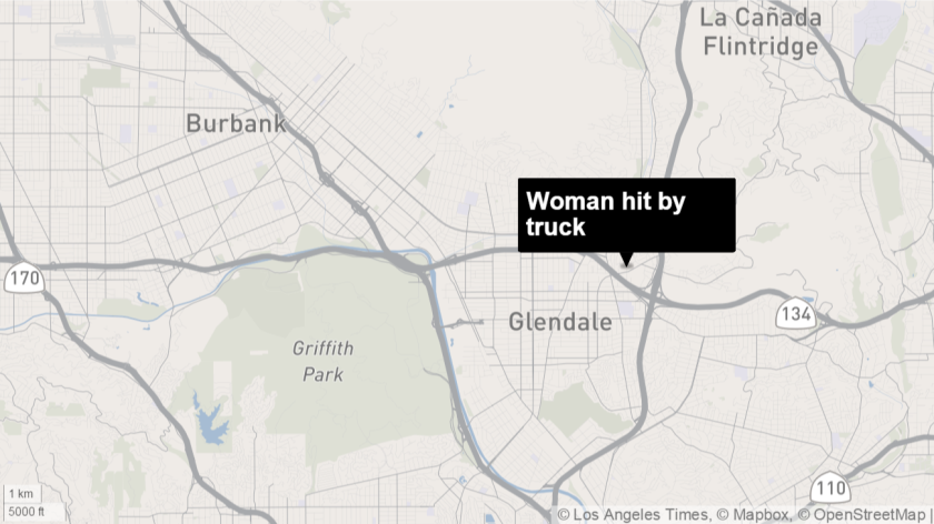 Woman hit by truck