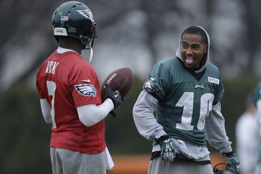 Philadelphia Eagles quarterback Michael Vick, left, meets with wide receiver DeSean Jackson during practice at the NFL football team's training facility, Thursday, Dec. 5, 2013, in Philadelphia. (AP Photo/Matt Rourke)