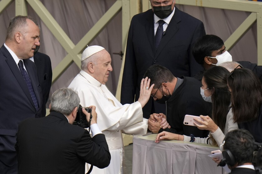 Pope Francis blesses and attendee as he arrives for his weekly general audience, at the Vatican, Wednesday, June 9, 2021. (AP Photo/Alessandra Tarantino)