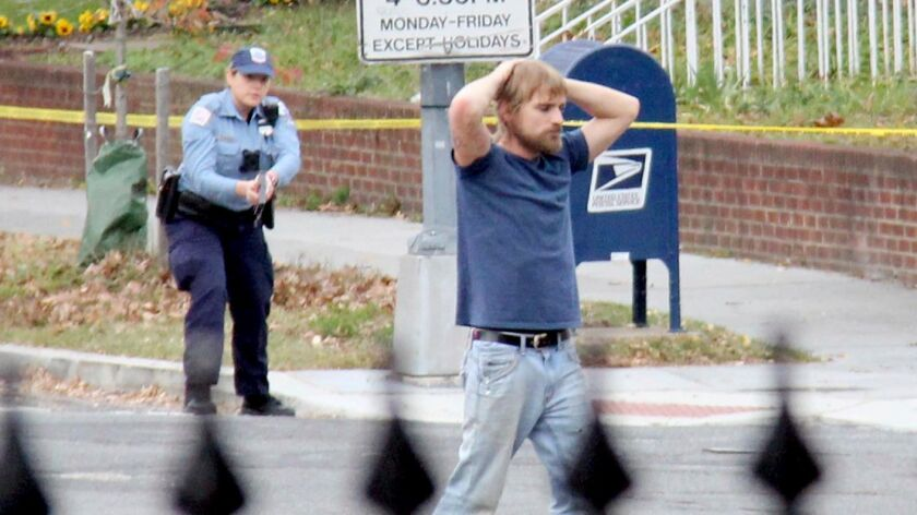 In Dec. 4, 2016, file photo, Edgar Maddison Welch, 28, surrenders to police in Washington after opening fire at a pizza restaurant. Police say Welch believed a bogus Internet conspiracy theory that Democrats harbored child sex slaves at the restaurant. (Associated Press)