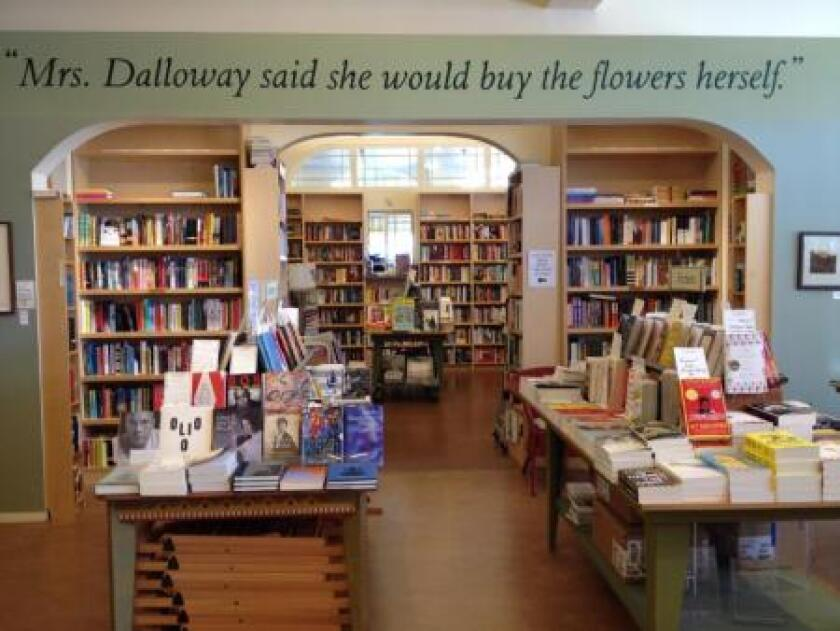"""A bookstore with """"Mrs. Dalloway said she would buy the flowers herself"""" written on the wall"""