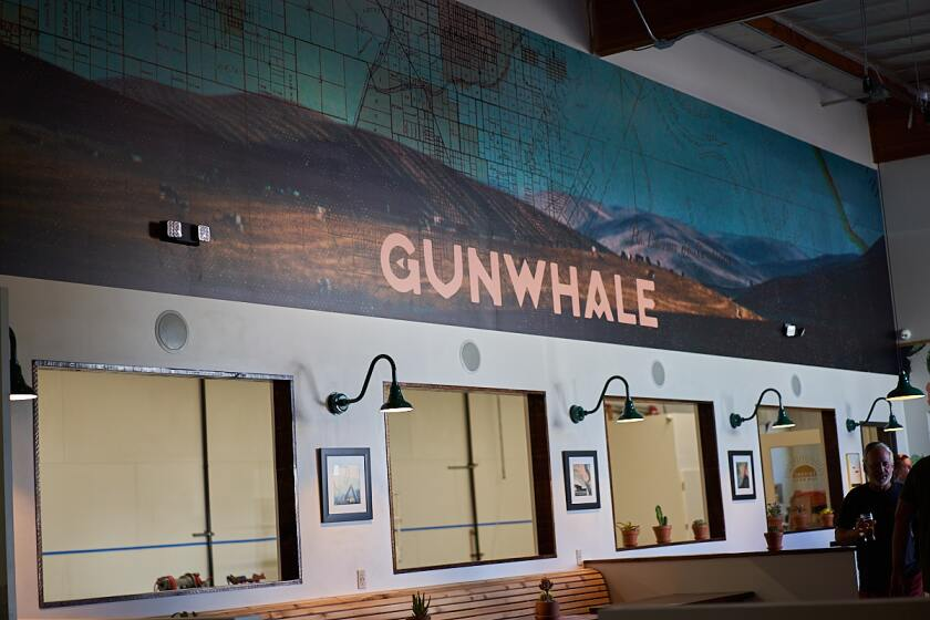 On one of the walls, Gunwhale Ales' logo is superimposed over artwork depicting a historic lot map of Orange as it existed a century or more ago.