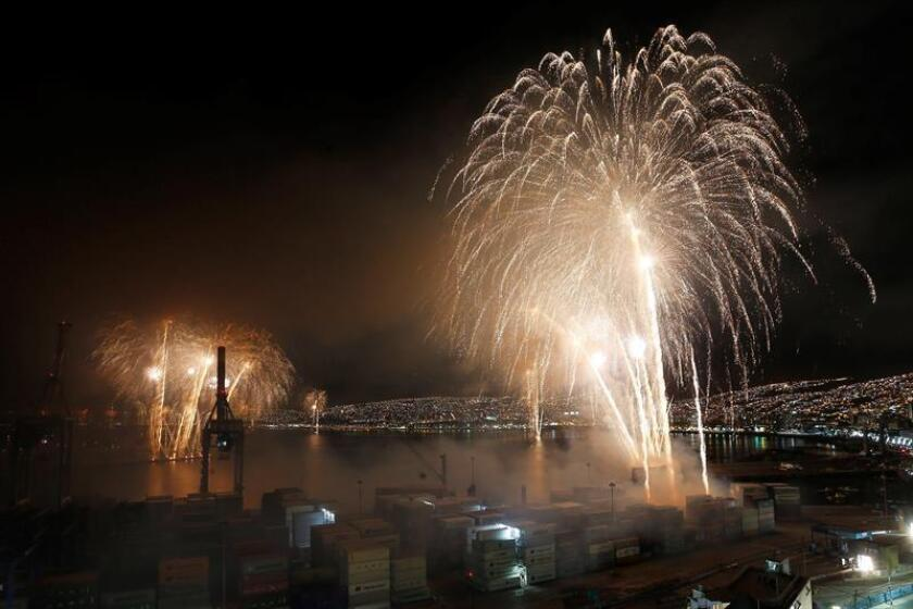Fireworks explode over the port during New Year's celebrations in Valparaiso, Chile, on Jan. 1, 2019. EPA-EFE/Raul Zamora