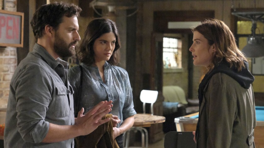 "Jake Johnson, left, Monica Barbaro and Cobie Smulders in a new episode of ""Stumptown"" on ABC."