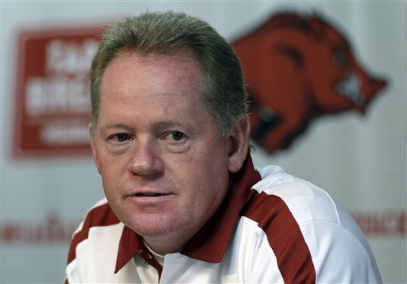 FILE - This Aug. 6, 2011 file photo shows Arkansas college football coach Bobby Petrino speaking to reporters in Fayetteville, Ark. A State Police official says Petrino crashed his motorcycle Sunday night, April 1, 2012, on Arkansas Highway 16 in Madison County near the community of Crosses, and was taken to a hospital for treatment. (AP Photo/Danny Johnston, File)