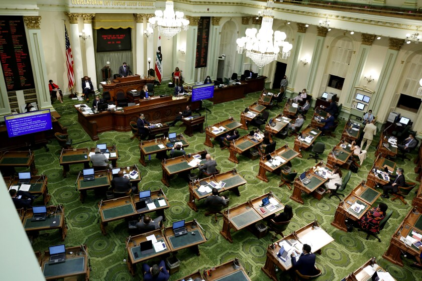 Members of the state Assembly meet to discuss the state budget at the Capitol in Sacramento, Calif., Tuesday, May 26, 2020