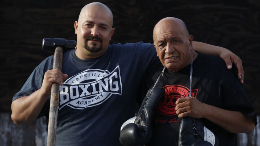 Javier Capetillo Jr, 41, left, and his father Javier Capetillo, 66, at Capetillo Boxing Academy in