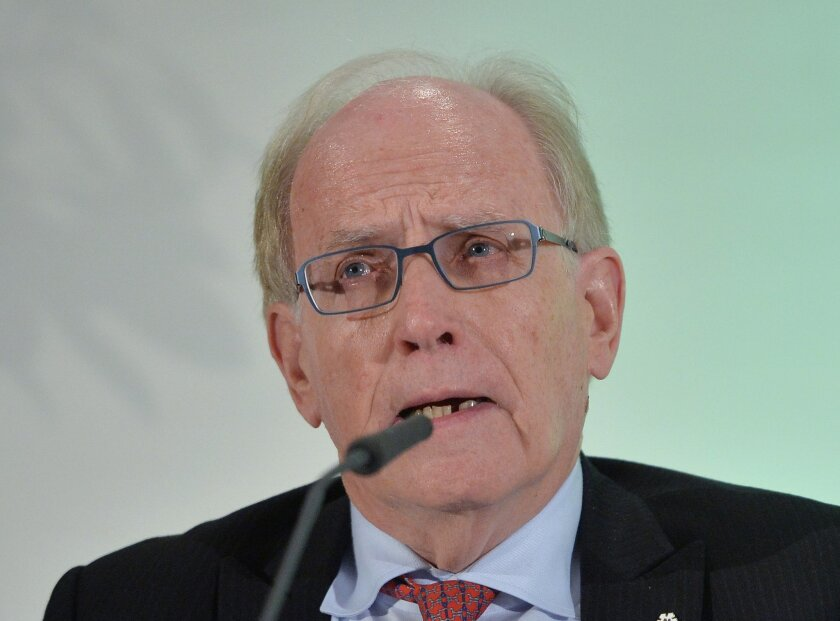 FILE - In this Thursday, Jan. 14, 2016 file photo, legal counsel Richard H. McLaren speaks as WADA's (World Anti-Doping Agency) Independent Commission (IC) presents the findings of his Commission's Report surrounding allegations of doping in sport, during a press conference in Munich, Germany. Cana