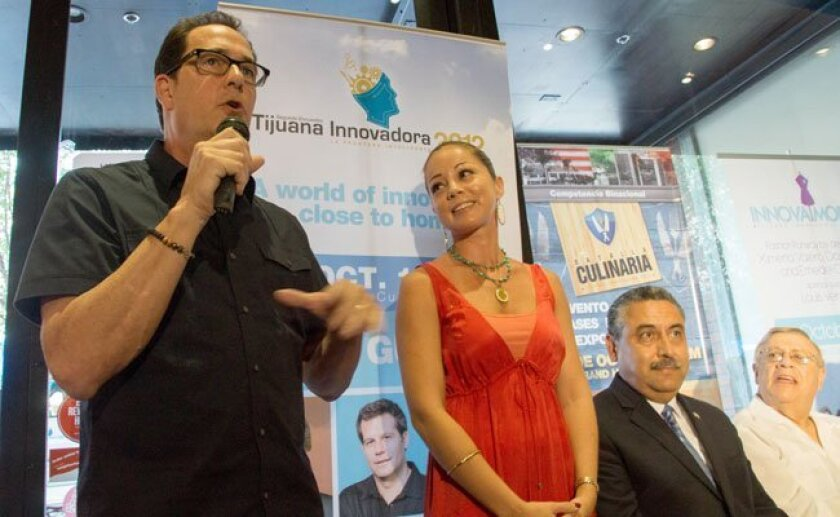 """TV personalities Sam """"The Cooking Guy"""" Zien and Marcela Valladolid pitch Tijuana Innovadora 2012 at a press conference Wednesday."""