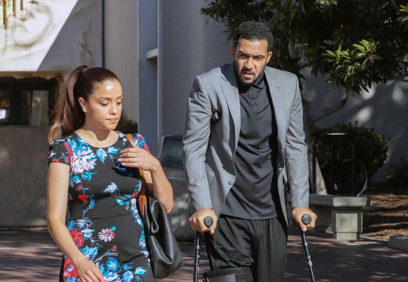 Kellen Winslow II and his wife Janelle leave San Diego Superior Court in Vista after his preliminary hearing scheduled for today was postponed until October 15th.