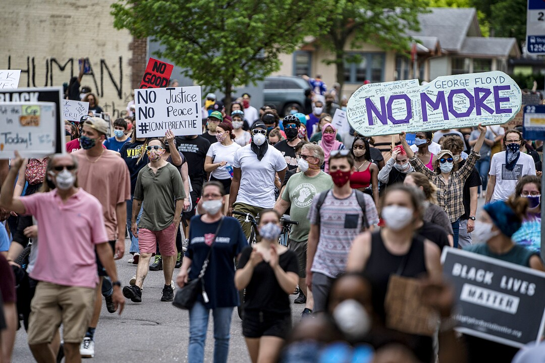 Demonstrators start marching toward a Minneapolis police station to protest the death of George Floyd.
