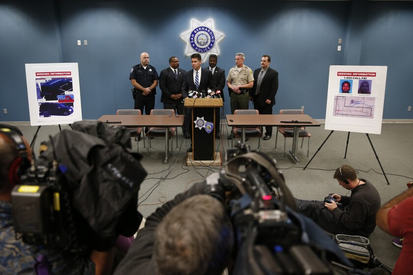 FBI Assistant Director David Bowdich, center, appeals to the public for information about the whereabouts of the San Bernardino attackers after the Dec. 2 massacre.