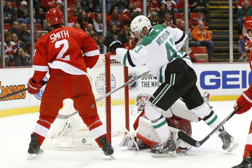 Dallas Stars' Valeri Nichushkin (43) celebrates his goal against the Detroit Red Wings in the first period of an NHL hockey game Sunday, Nov. 8, 2015, in Detroit. (AP Photo/Paul Sancya)