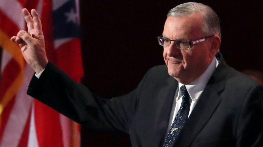 Sheriff Joe Arpaio, of Arizona, walks onto the stage to speak during the final day of the Republican National Convention in Cleveland in July. Arpaio was decisively defeated in the election on Nov. 8.