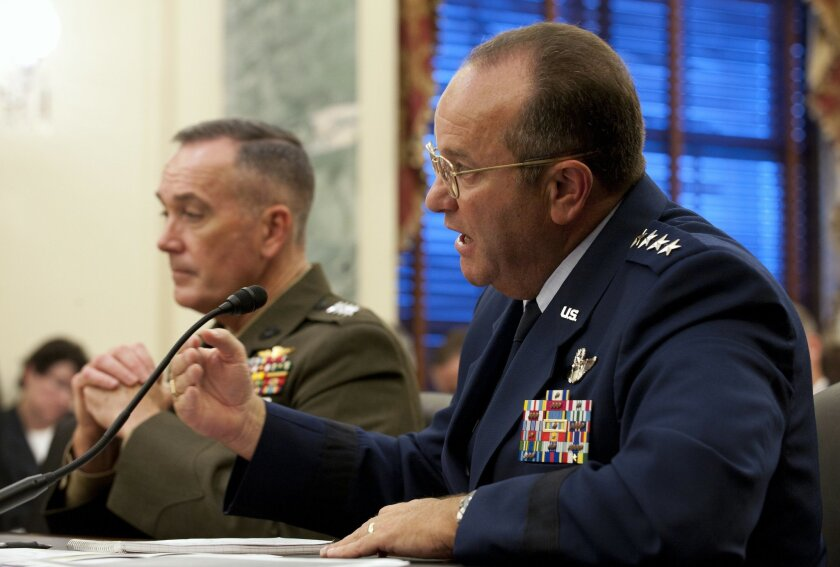 Air Force Vice Chief of Staff Gen. Phil Breedlove (right) answers a question about general officer and senior executive service authorizations in the military Sept. 14, 2011, in Washington, D.C., during a hearing of the Senate Armed Services Committee's Subcommittee on Personnel. Also pictured is A