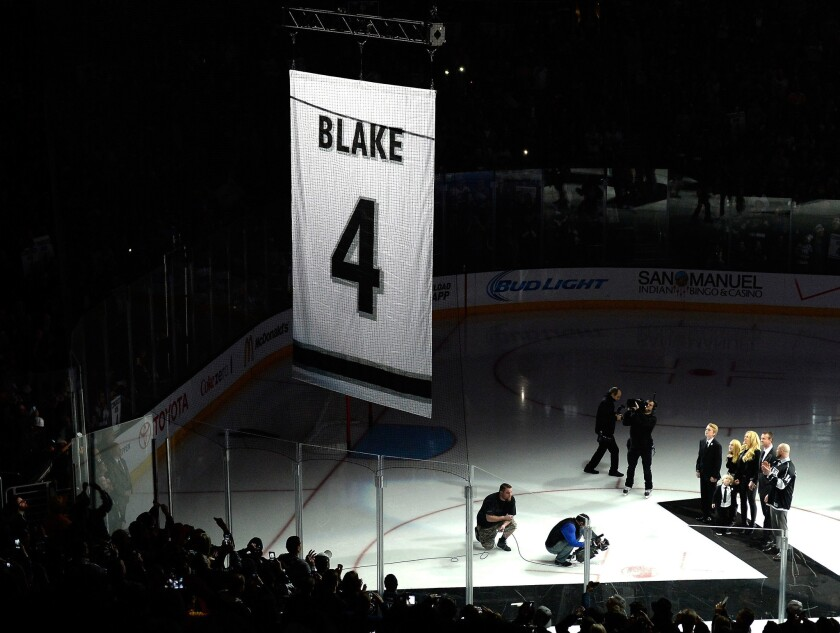Rob Blake watches along with family members as a banner with his Kings jersey number is raised at Staples Center.