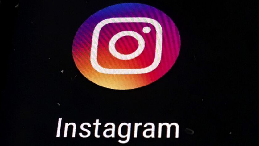 In this Thursday, Nov. 29, 2018, photo, the Instagram app logo is displayed on a mobile screen in Lo