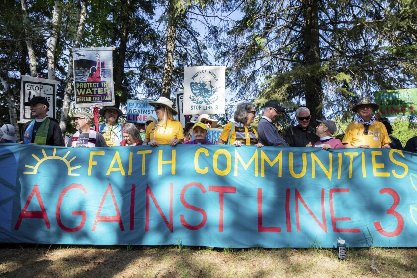 Faith leaders gather for an interfaith prayer gathering before a day of protest action against the Enbridge Line 3 oil pipeline at LaSalle Lake State Recreation Area on Monday, June 7, 2021. (Evan Frost/Minnesota Public Radio via AP)