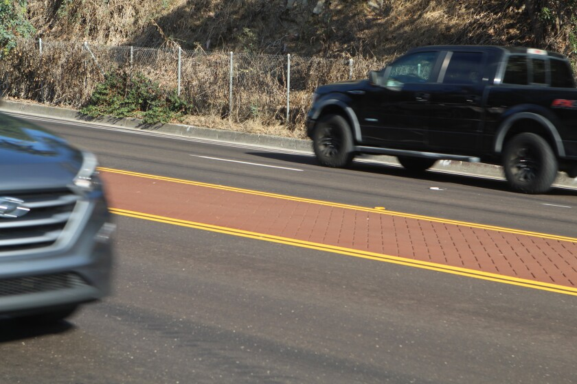 The stamped median on Torrey Pines Road resembles in-laid brick.