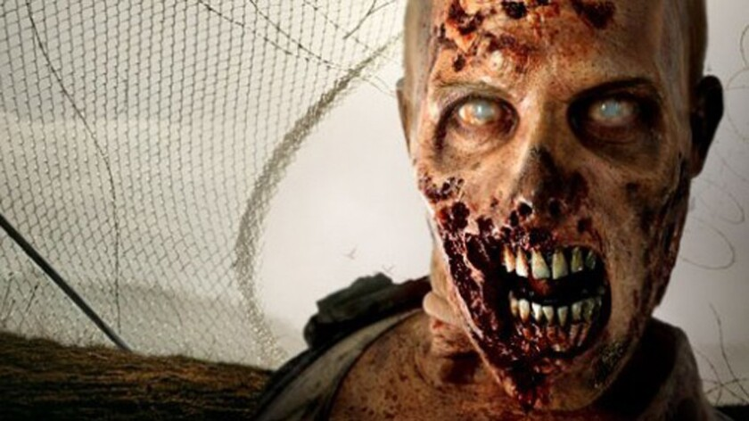 Is this the face of AMC? Spain's Parque de Atracciones converted the year-round El Viejo Caseron maze into the Walking Dead Experience.