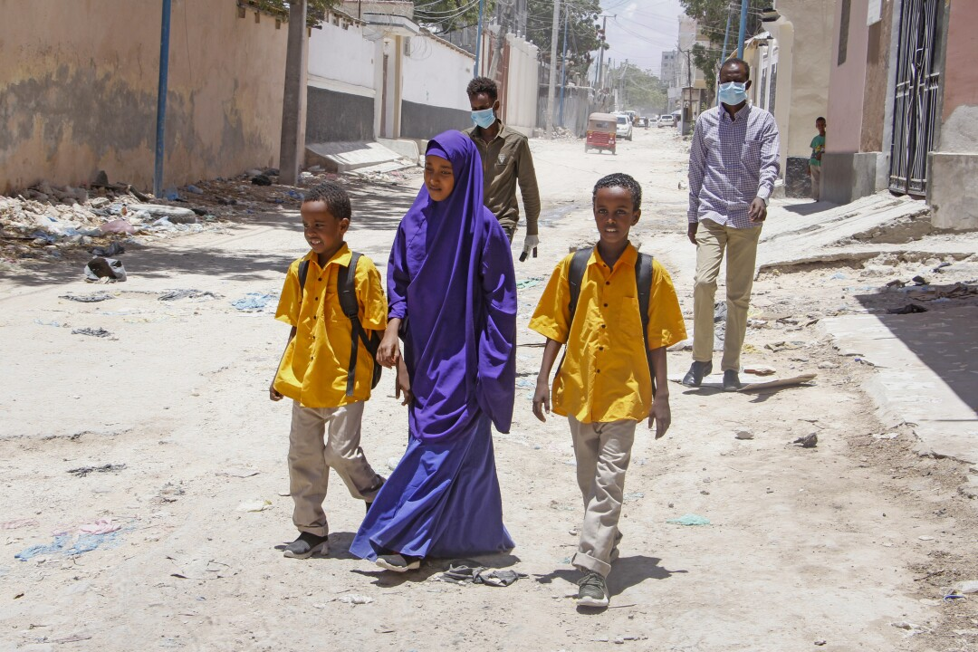 Children walk home in Mogadishu, Somalia, in March after the government announced the closure of schools.