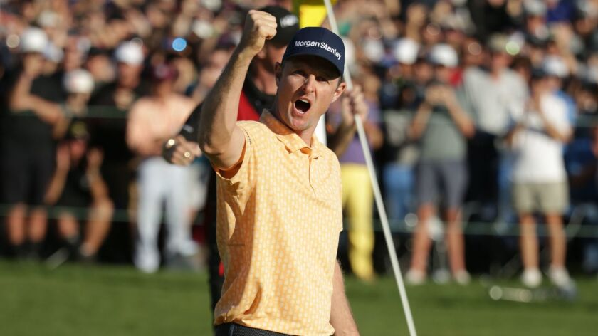 Justin Rose celebrates his winning putt on the 18th green on the South Course during the final round of the Farmers Insurance Open at Torrey Pines.