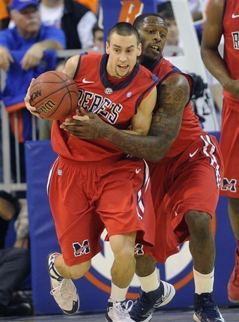 Mississippi guard Marshall Henderson (22) and forward Murphy Holloway (31) control the ball on a steal during the second half of an NCAA college basketball game against Florida in Gainesville, Fla., Saturday, Feb. 2, 2013. Florida defeated Mississippi 78-64.  (AP Photo/Phil Sandlin)