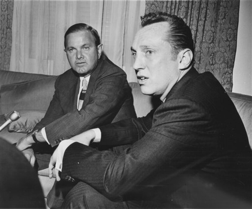 FILE- In this April 8, 1966, file photo, Al Davis, right, the head coach-general manager of the Oakland Raiders, and Ralph Wilson, president of the AFL and owner of the Buffalo Bills, look on after Davis was selected as the new American Football League commissioner in Houston. The Raiders announced