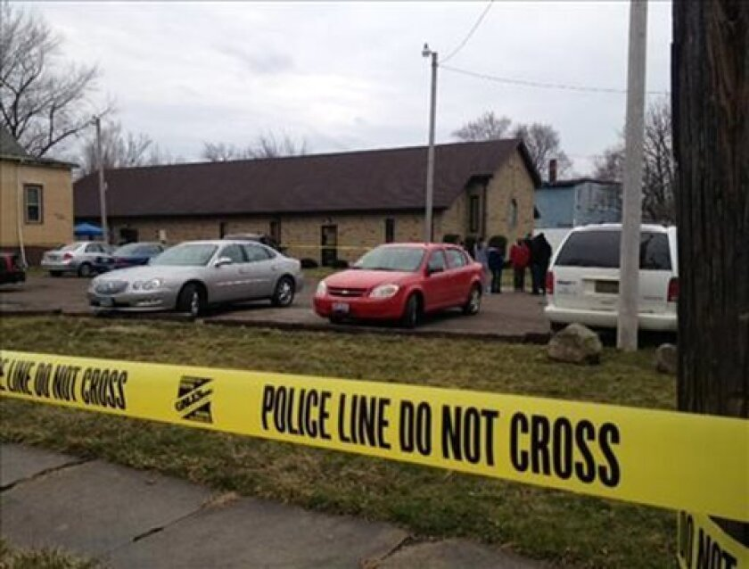 This image provided by WKYC, Channel 3, shows the scene outside a church in Ashtabula, Ohio, on Sunday, March 31, 2013. Police in northeast Ohio are investigating a shooting outside the church that has reportedly left one man dead after an Easter service. (AP Photo/WKYC)