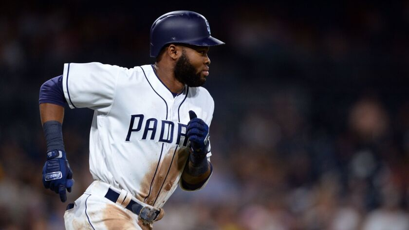 San Diego Padres center fielder Manuel Margot runs to first base after hitting a single during the second inning against the Arizona Diamondbacks Tuesday, Sept. 19, 2017, in San Diego.