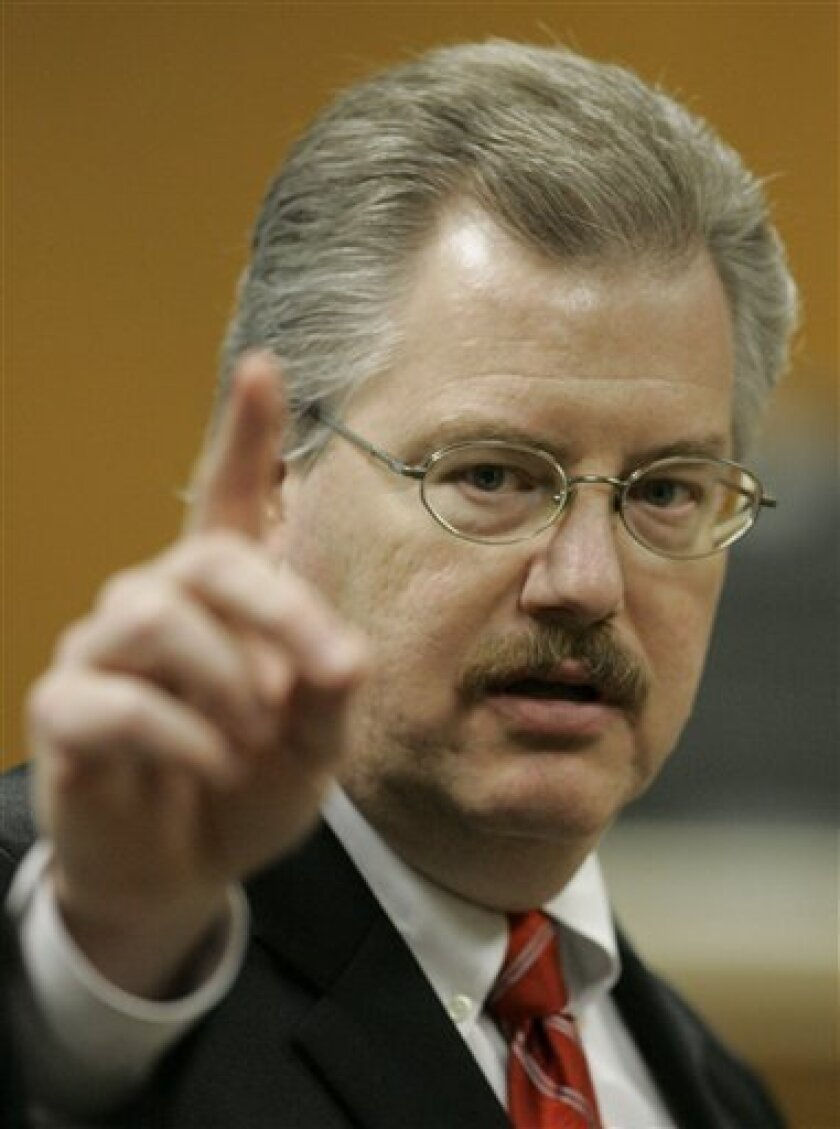 FILE - In this March 14, 2007 file photo, Calumet County District Attorney Ken Kratz gives closing arguments during a trial at the Calumet County Courthouse in Chilton, Wis. The Associated Press reported last month that Kratz sent 30 text messages to a domestic abuse victim while he prosecuted her ex-boyfriend on a strangulation charge. Kranz issued a statement on Monday, Oct. 4, 2010, saying he has resigned and that he has lost the confidence of the people he represents. He also apologized to his family for embarrassing them. (AP Photo/Morry Gash, Pool, File)