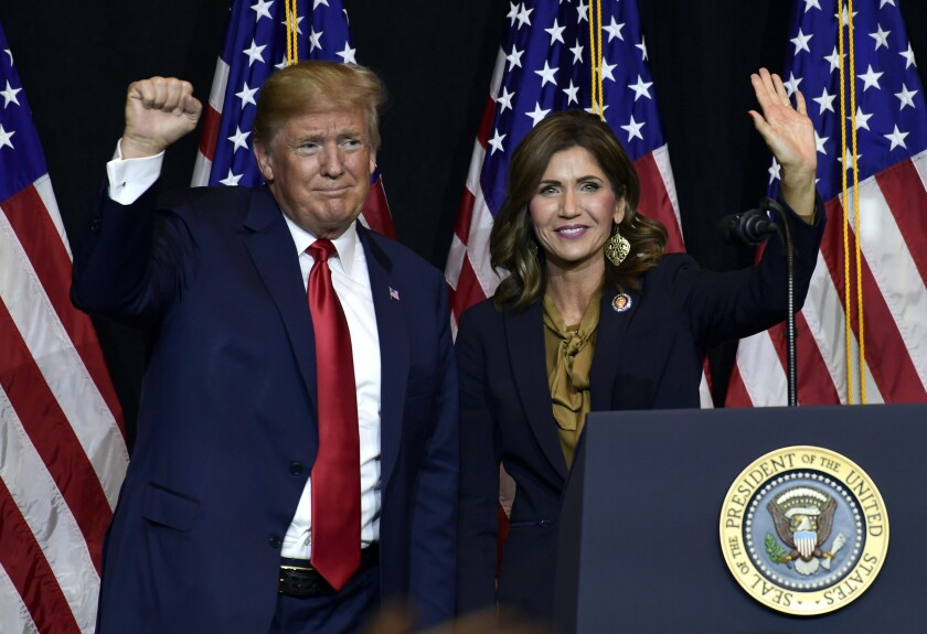 FILE - In this Sept. 7, 2018 file photo President Donald Trump appears with Gov. Kristi Noem in Sioux Falls, S.D. South Dakota officials said Wednesday, Aug. 12, 2020, they plan to erect a security fence budgeted around the official governor's residence to protect Noem. Noem's office did not give specifics on any threats. The South Dakota Republican has championed a hands-off approach to managing the coronavirus crisis and also raised her national political profile in the past year, including tying herself more closely to Trump. (AP Photo/Susan Walsh, File)