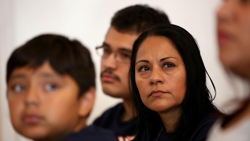 Sujey Becerra, 39, with her two sons at a wellness and nutrition class at Todec Legal Center in Perris, California, in May 2015. Becerra is an undocumented immigrant without health insurance and depends on county-run health programs.