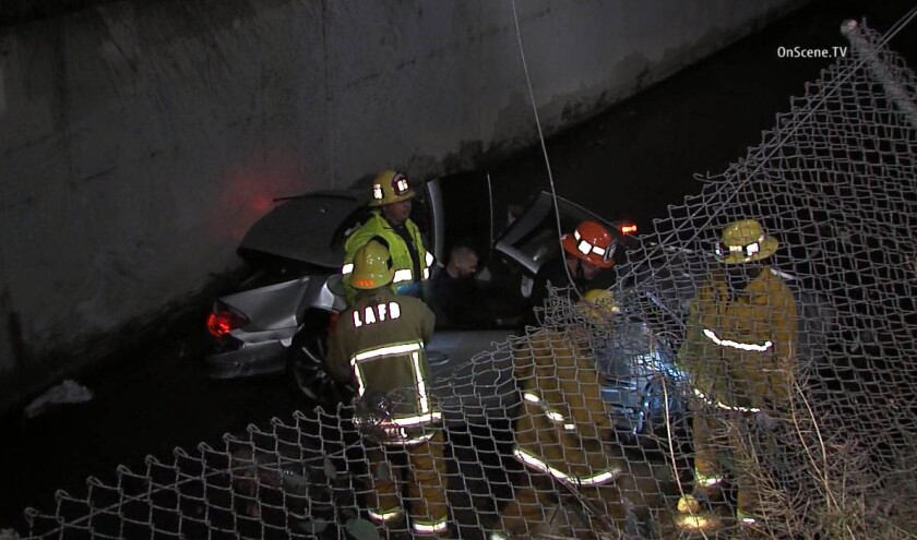 At least one person was injured early Wednesday when a car crashed into a flood control channel in the 11200 block of Riverside Drive in North Hollywood.