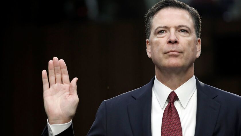 Former FBI Director James Comey is sworn in during a Senate Intelligence Committee hearing on Capito