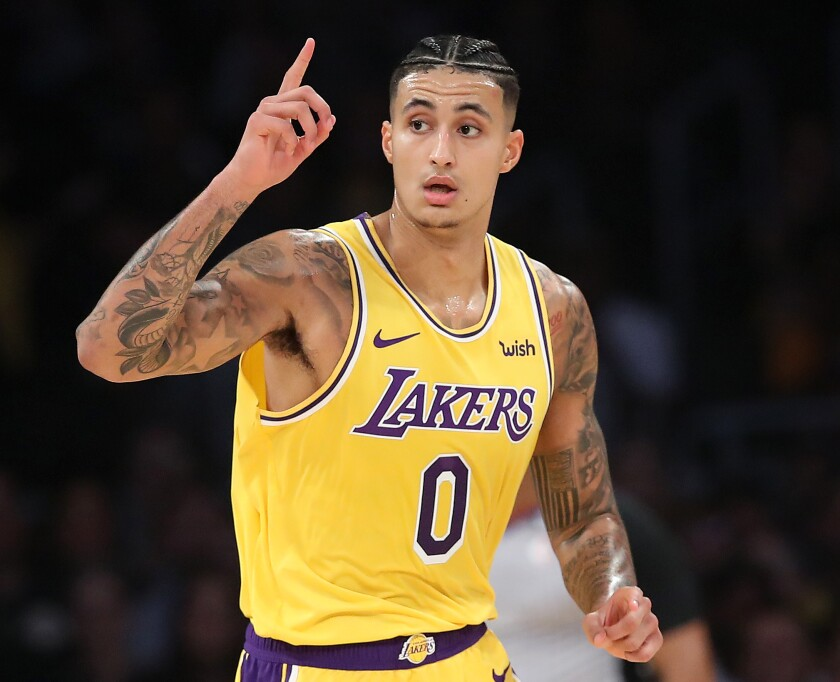 Kyle Kuzma of the Lakers reacts after making a three-point shot.