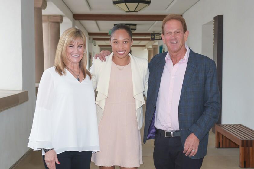 Allyson Felix with Ellen and Steven Osinski, primary sponsors of the event