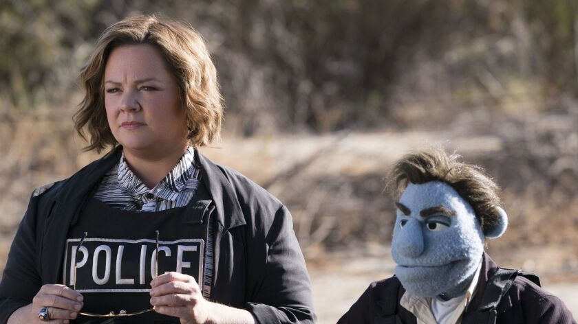 "Melissa McCarthy (left) stars in ""The Happytime Murders."" Credit: Hopper Stone / STX Entertainment"