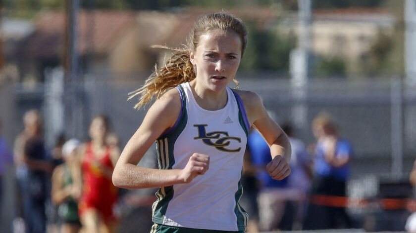 La Costa Canyon's Kristin Fahy (shown in a meet last season) cruised to victory in the girls 3200-meter run at 10:35.31, destroying the meet record.