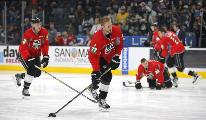 Los Angeles Kings' Jeff Carter, center, skates during warm ups before a game against the San Jose Sharks on Dec. 22.