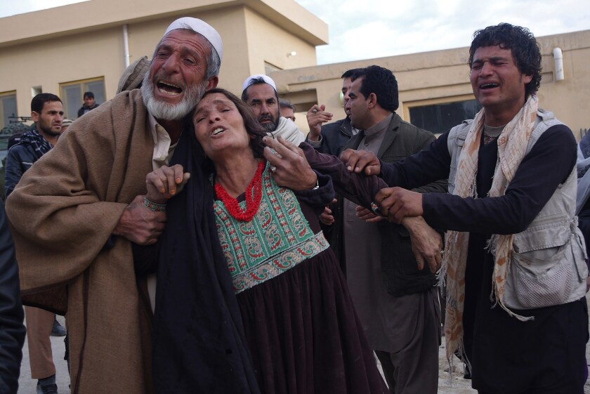 Relatives weep for victims of a suicide attack on a funeral in Afghanistan's Laghman province on Jan. 29.