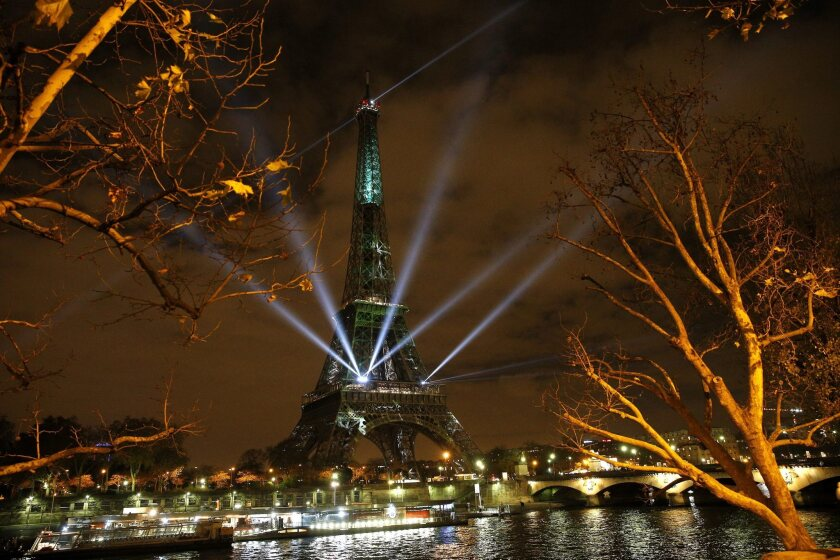The Eiffel Tower is arrayed with spcial lights and messages of hope on Nov. 29, the eve of the climate change conference in Paris.