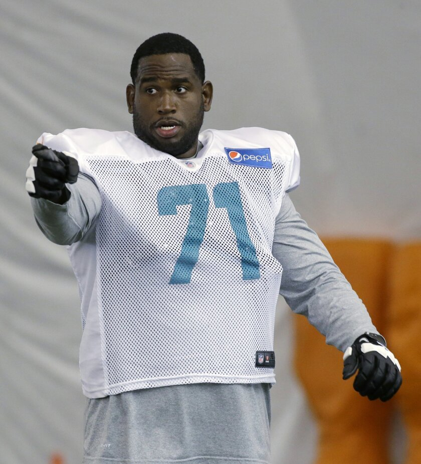 In this Aug. 11, 2015, photo, Miami Dolphins tackle Branden Albert (71) is shown during an NFL football training camp practice in Davie, Fla. Albert has been cleared to practice wire to wire for the first time since being sidelined in Week 10 last season with a torn ACL and MCL in his right knee.(AP Photo/Wilfredo Lee)