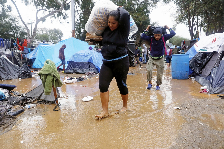 Rain drenches Tijuana migrant camp