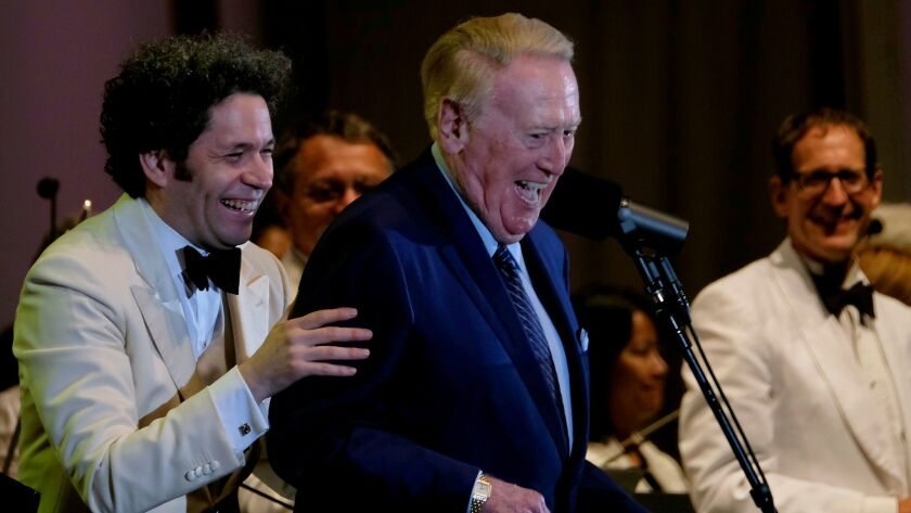 LOS ANGELES, CA JULY 13, 2017: Gustavo Dudamel and Vin Scully react after they preform at the Holl